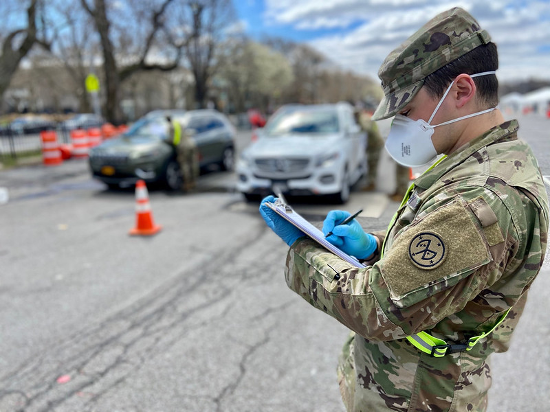 The New York Army National Guard records the personnel count entering through a COVID-19 testing site. (Source: Official National Guard photo by 1st Lt. Kyle Kilner)